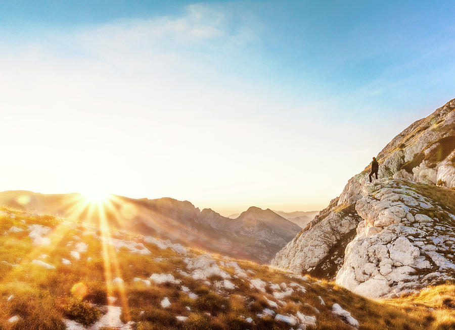 Young Adult Photograph - Hiker Standing On Rock Formation by Marko Radovanovic