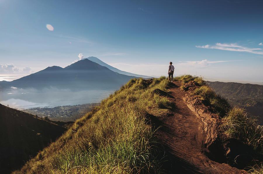 Hiker Staying On Top Of  Mount Batur Photograph by Alex Grabchilev / Evgeniya Bakanova
