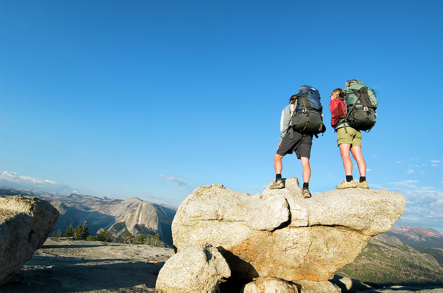 Active Photograph - Hikers Stand On Rock On Sentinel Dome by Lars Schneider