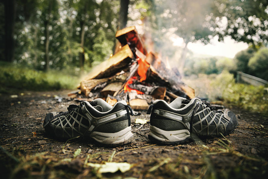 Wood Photograph - Hiking Shoes Drying Beside Campfire by Marko Radovanovic