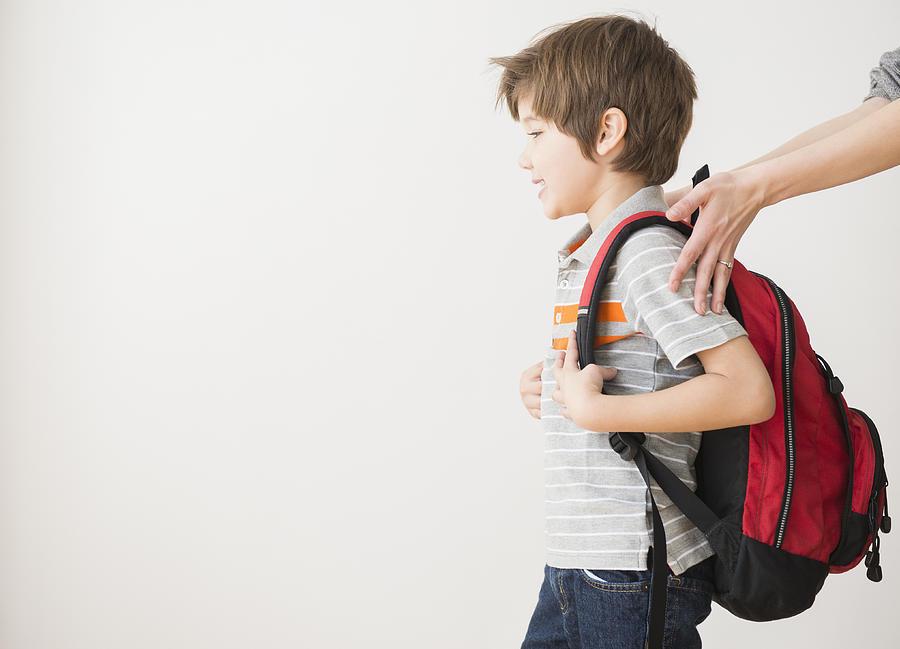 Hispanic mother rushing son to school Photograph by JGI/Jamie Grill
