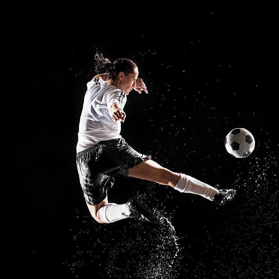 Hispanic Soccer Player Splashing In Photograph by Erik Isakson