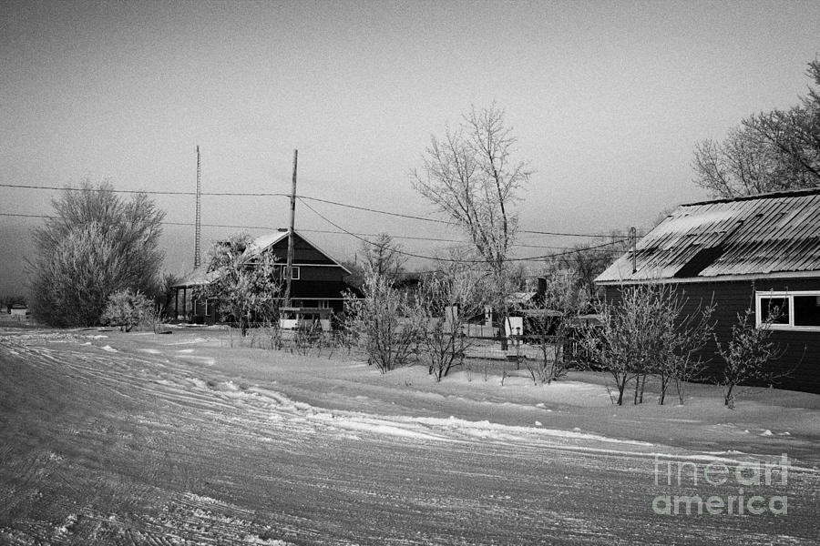 Hoar Photograph - hoar frost covered street in small rural village of Forget Saskatchewan Canada by Joe Fox