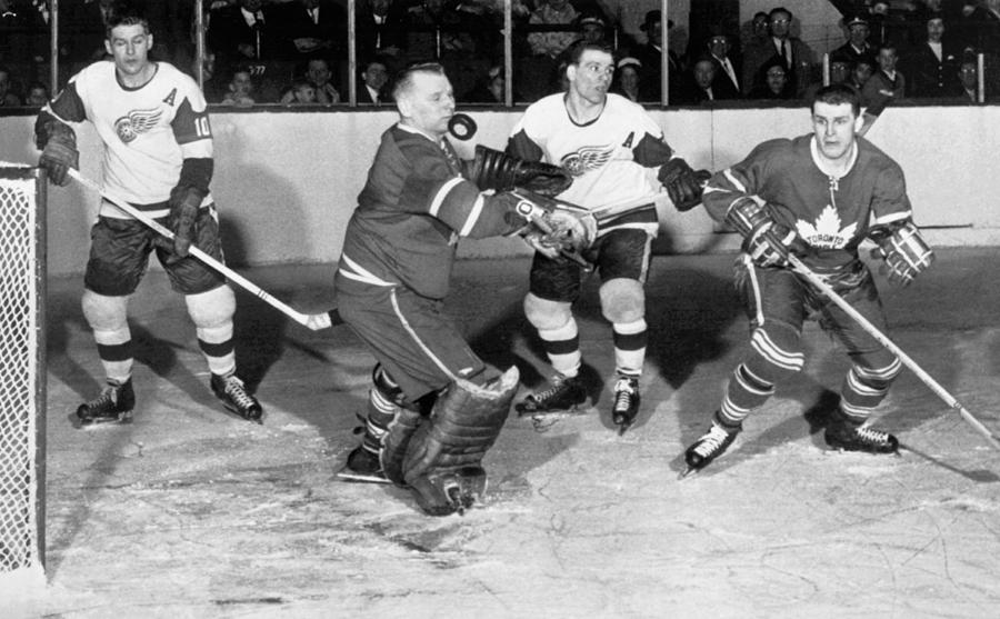 1950s Photograph - Hockey Goalie Chin Stops Puck by Underwood Archives