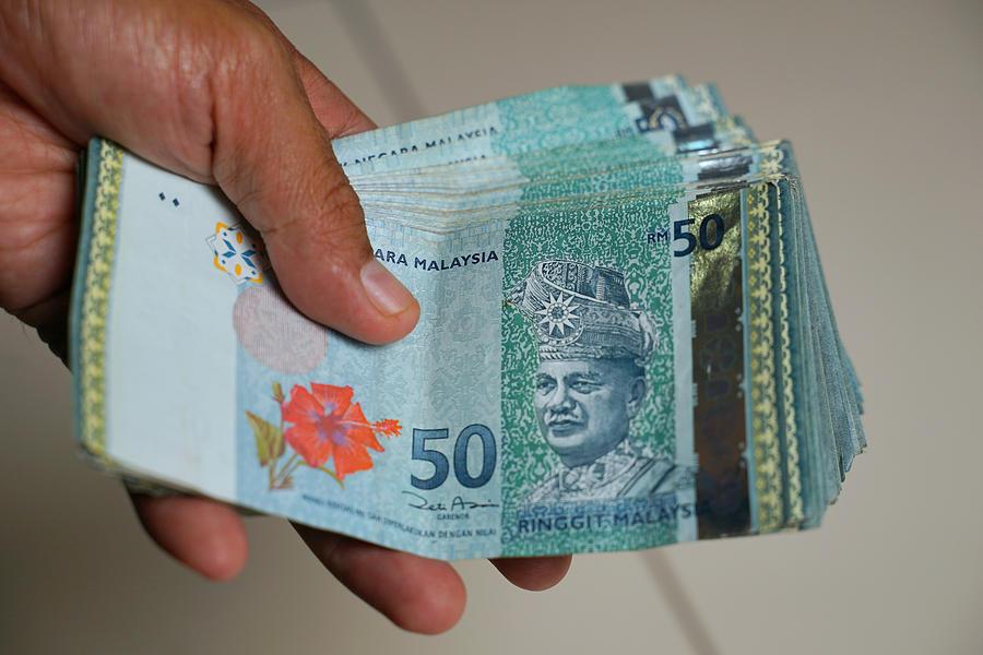 Holding Malaysian ringgit Photograph by Imran Kadir Photography