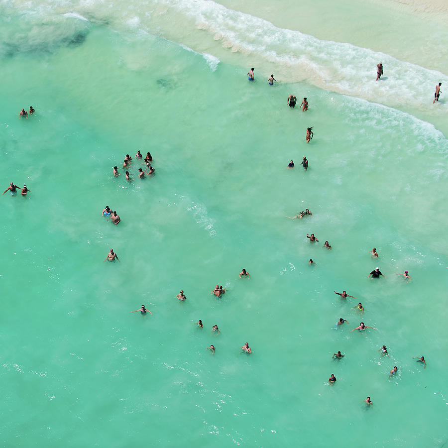 Holiday Makers Cooling Off In The Sea Photograph by Tommy Clarke