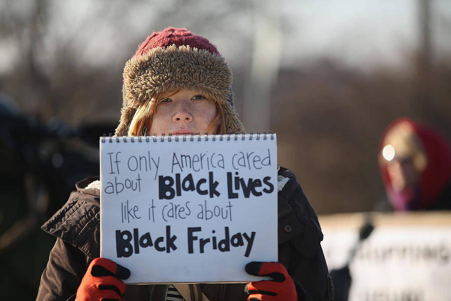Holiday Shopping Begins In Ferguson As Protests Continue Photograph by Scott Olson
