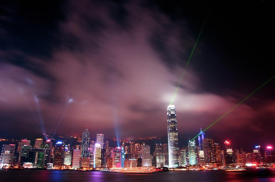 Hong Kong Laser Lights Photograph by Photo By Dan Goldberger
