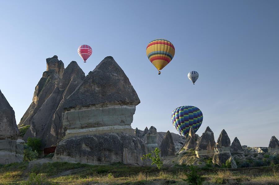Hot-air Ballooning In Cappadocia Photograph by Izzet Keribar