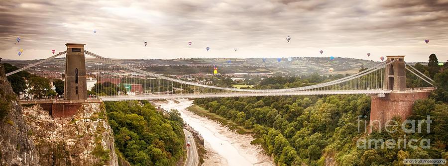 Balloons Photograph - Hot air balloons behind suspension bridge by Simon Bratt Photography LRPS