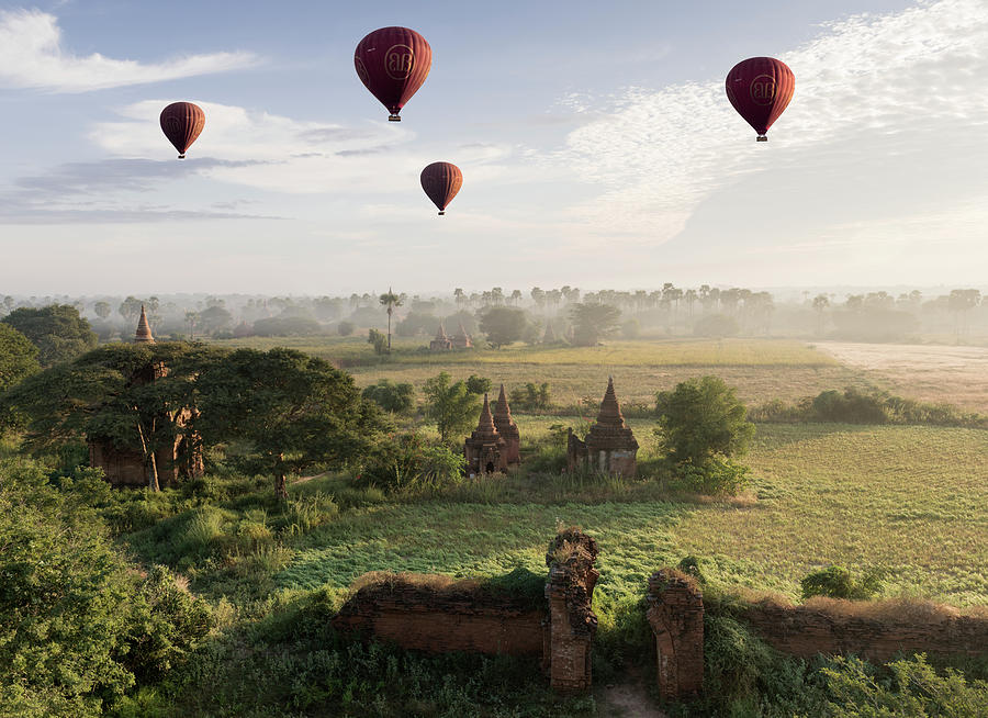 Hot Air Balloons Flying Over Ancient Photograph by Martin Puddy