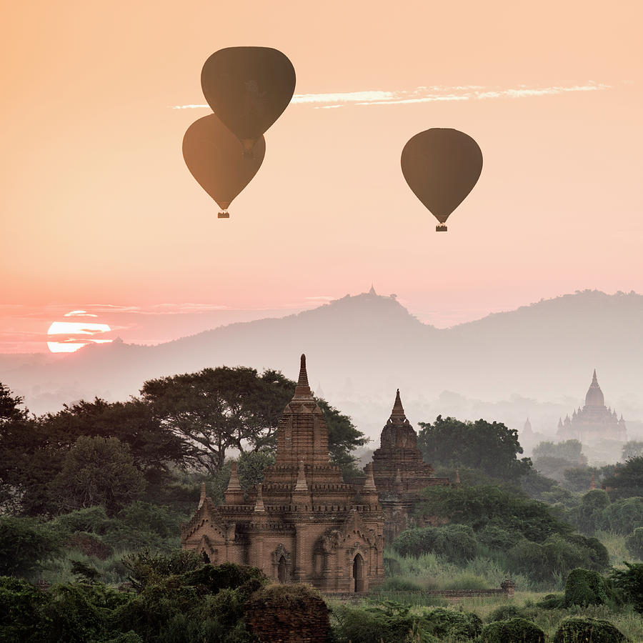 Hot Air Balloons Flying Over Temples At Photograph by Martin Puddy