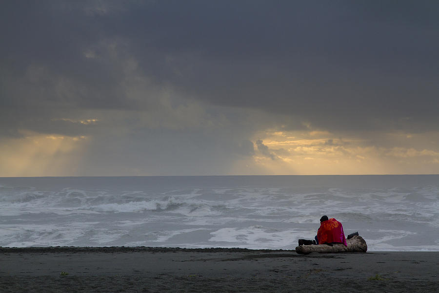 Huddled On The Beach Photograph