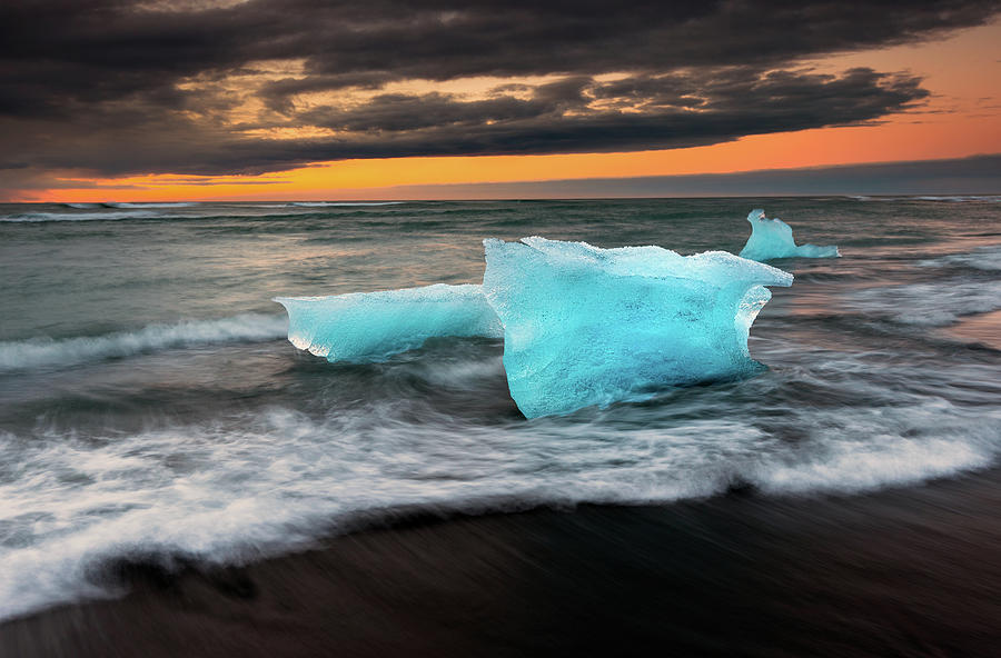 Icebergs At Jokulsarlon Black Sand Photograph by Noppawat Tom Charoensinphon