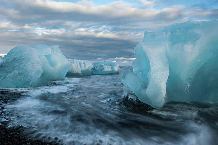 Icebergs On The Beach At Jökulsárlón Photograph by Janet Miles