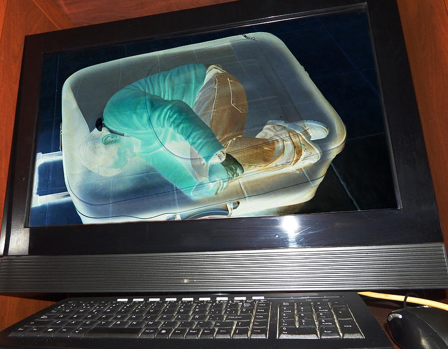 Illegal Immigrant Detected At An Airport On An X-ray Machine Photograph by Japatino