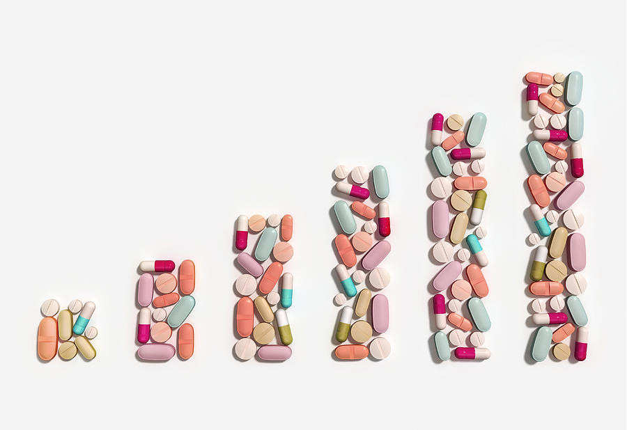 Abundance Photograph - Illustration Of Rising Cost Of Prescription Drugs by Fanatic Studio / Science Photo Library