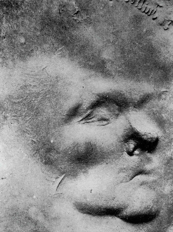 Image Of A Face Formed In Putty By Psychic Force by Science Photo Library