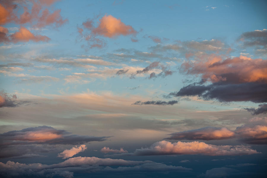 Clouds Photograph - In The Clouds by Tony Santo