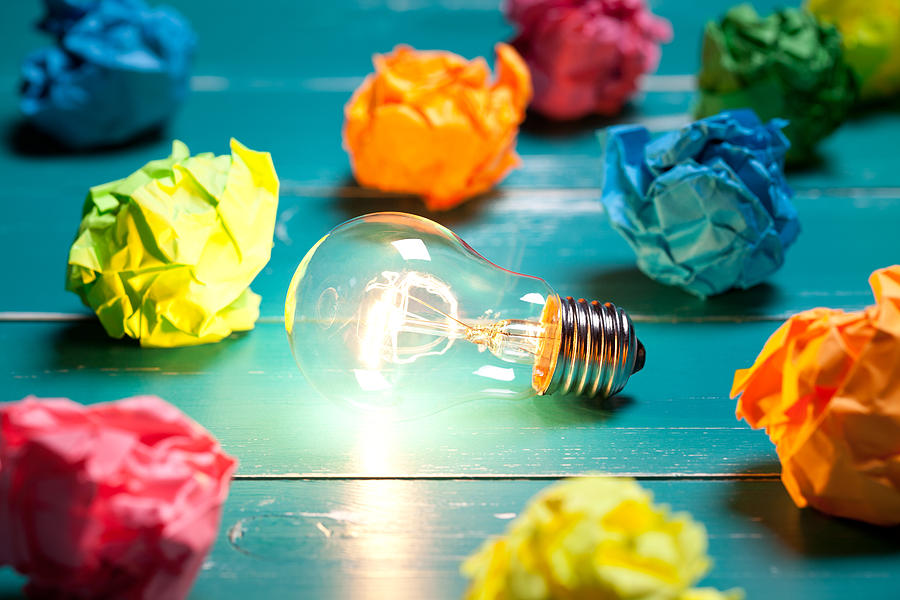 Incandescent Bulb And Colorful Notes On Turquoise Wooden Table Photograph by Xxmmxx
