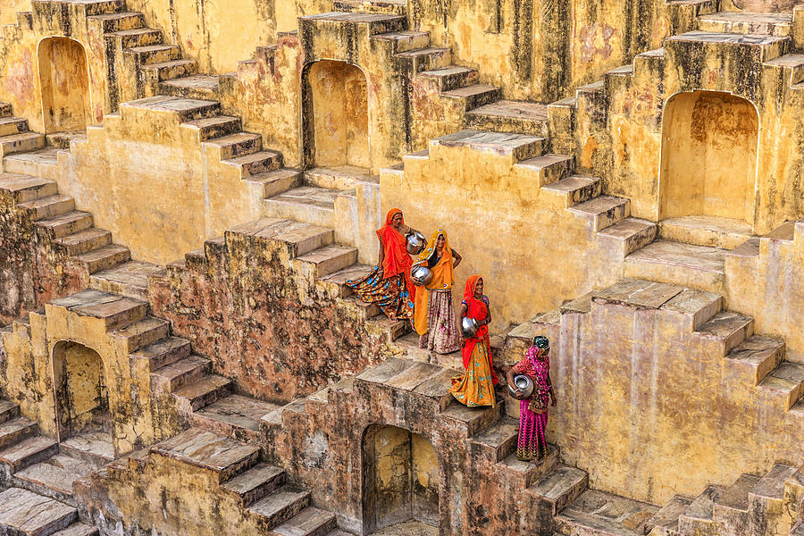 Indian women carrying water from stepwell near Jaipur Photograph by Hadynyah