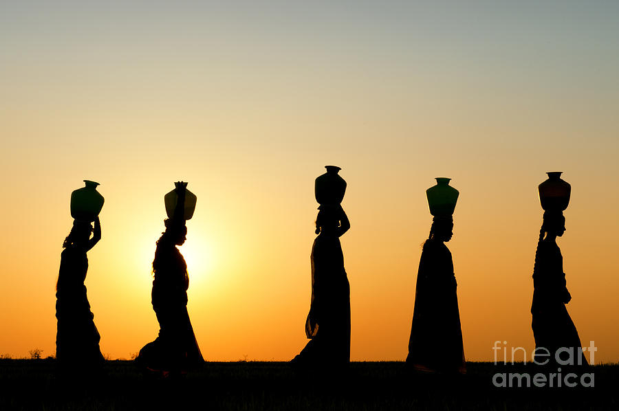 India Photograph - Indian Women Carrying Water Pots At Sunset by Tim Gainey
