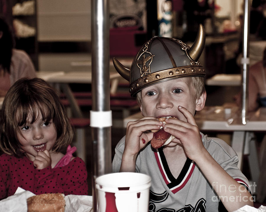 Is She Adoring Her Viking Or Coveting His Lunch Photograph