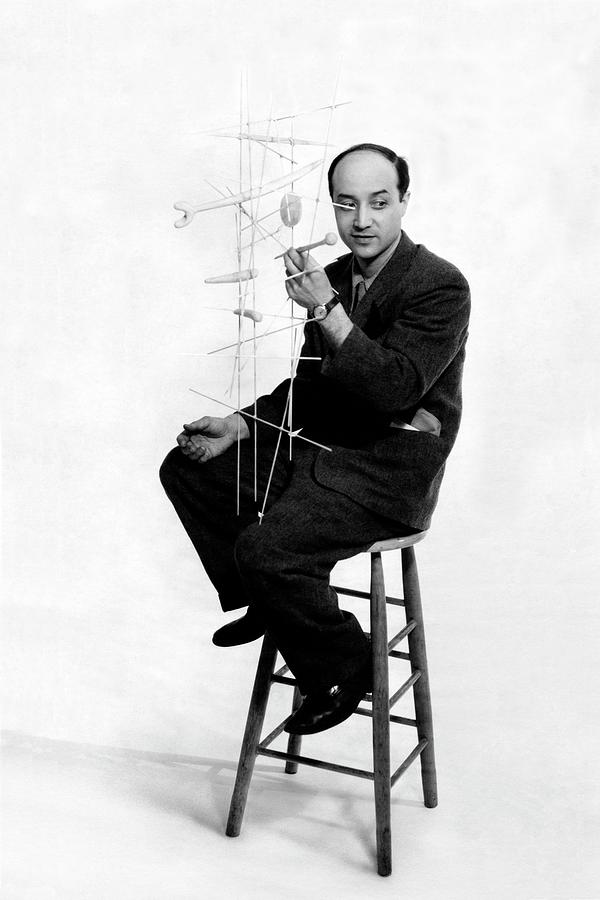 Isamu Noguchi Holding One Of His Structures Photograph by Herbert Matter