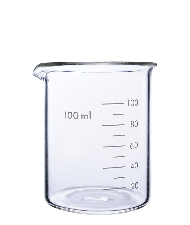 Isolated shot of empty measuring beaker on white background Photograph by Kyoshino