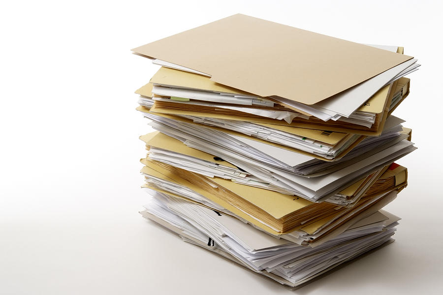Isolated Shot Of Stacked File Folders On White Background Photograph by Kyoshino
