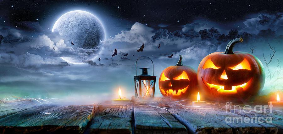 Symbol Photograph - Jack O' Lanterns Glowing At Moonlight by Romolo Tavani