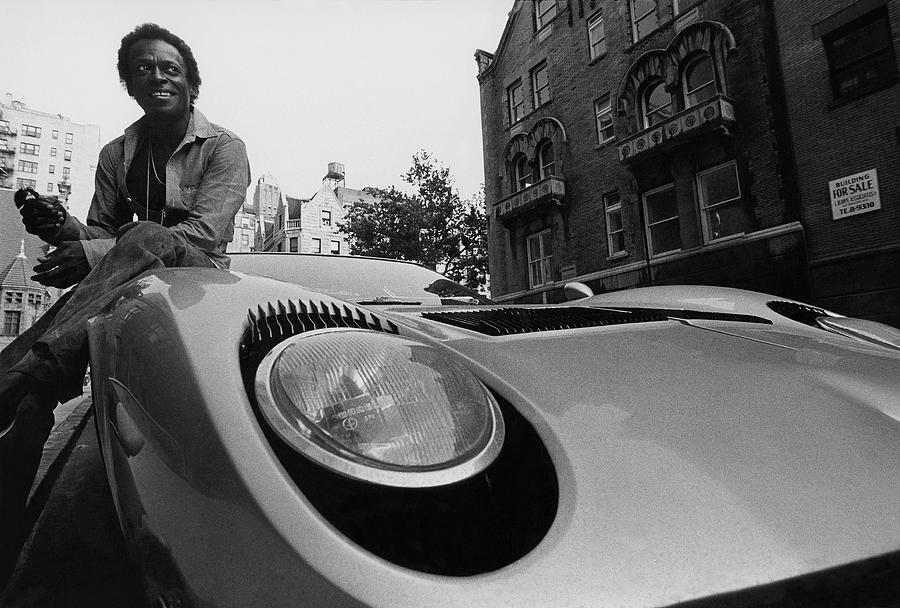 Jazz Musician Miles Davis Sitting On The Hood Photograph by Mark Patiky