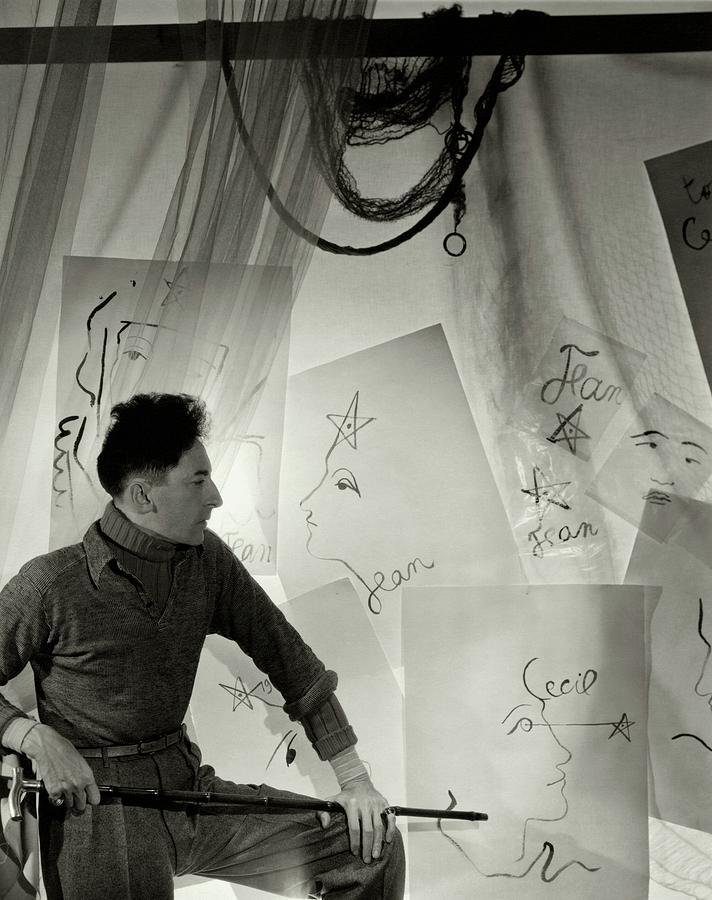Jean Cocteau With A Cane And Drawings Photograph by Cecil Beaton