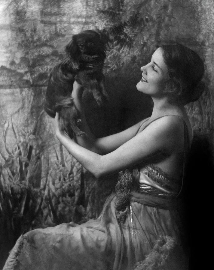 Jeanne Eagels Lifting Up A Small Dog Photograph by Arnold Genthe