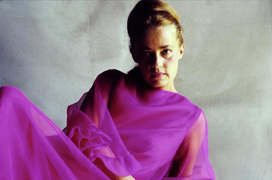 Jeanne Moreau Wearing A Purple Dress Photograph by Bert Stern