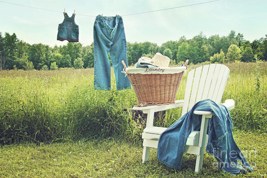 Blue Photograph - Jeans Hanging On Clothesline On A Summer Afternoon by Sandra Cunningham