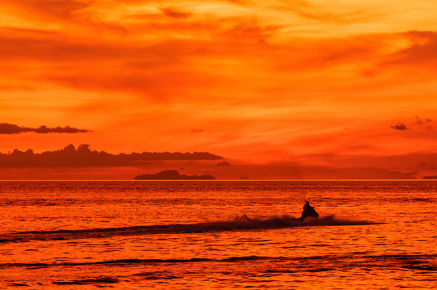 Asia Photograph - Jetski Ride Into The Sunset by Colin Utz