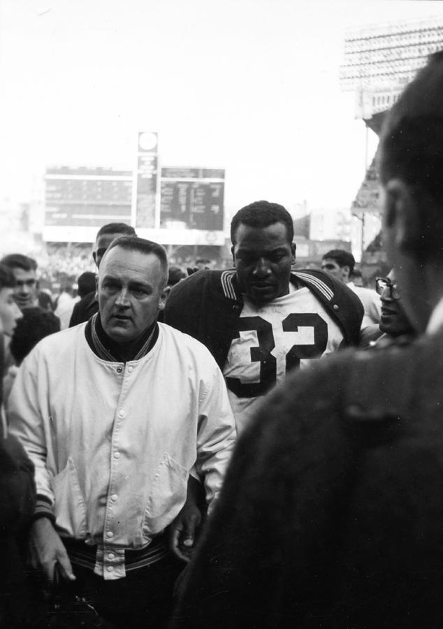 Marvin Newman Photograph - Jim Brown The Great Leaving The Field by Retro Images Archive