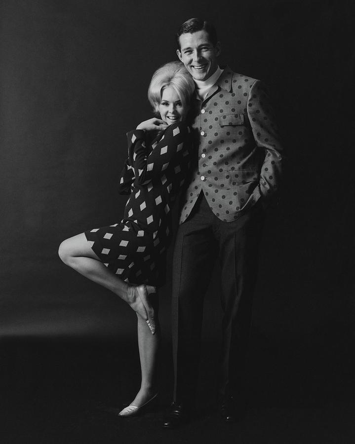 Joey Heatherton Posing With A Male Model Photograph by Leonard Nones
