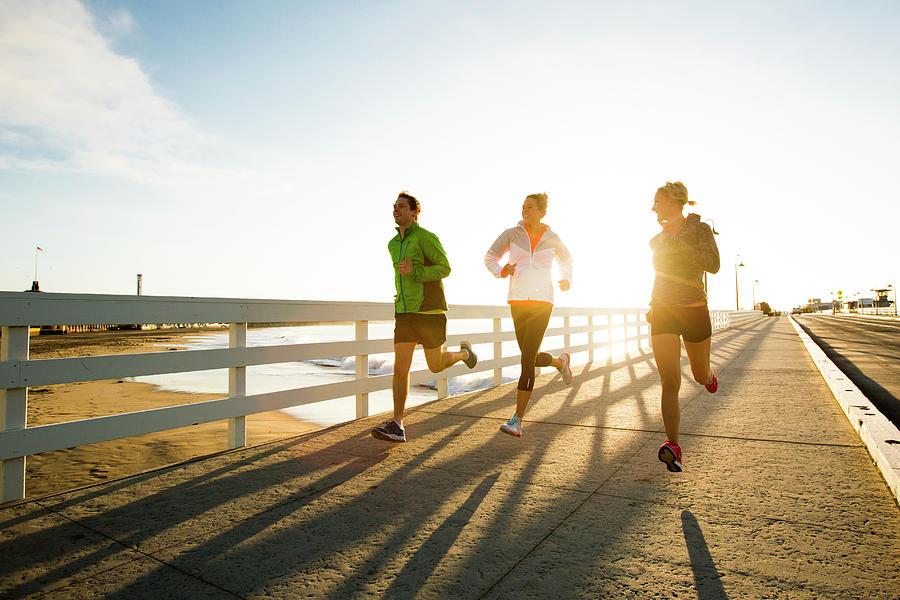 Jogging Along The Coast Photograph by Jordan Siemens