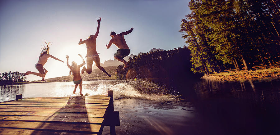 Jumping Into The Water From A Jetty Photograph by Wundervisuals