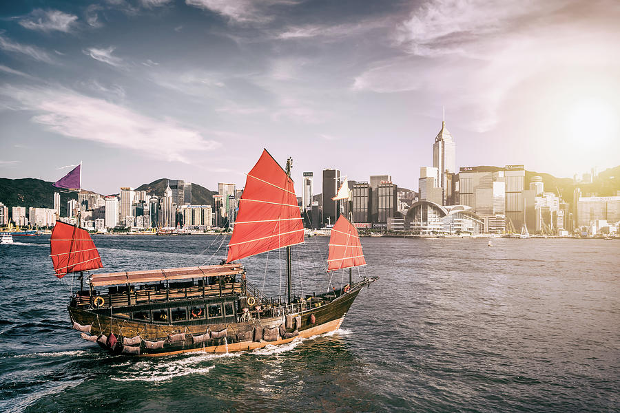 Junk Boat In Victoria Harbour Photograph by Yongyuan Dai