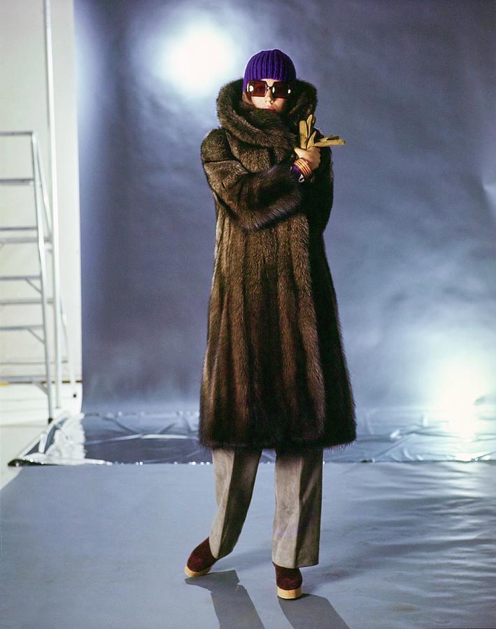 Justine Cushing Wearing A Fur Coat Photograph by Gianni Penati