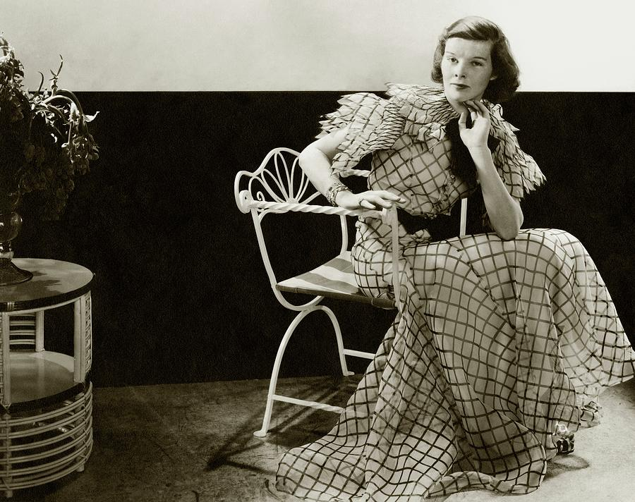 Katharine Hepburn Sitting On A Chair Photograph by Lusha Nelson