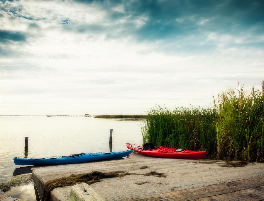 Kayaks By Waters Edge Photograph by Catlane