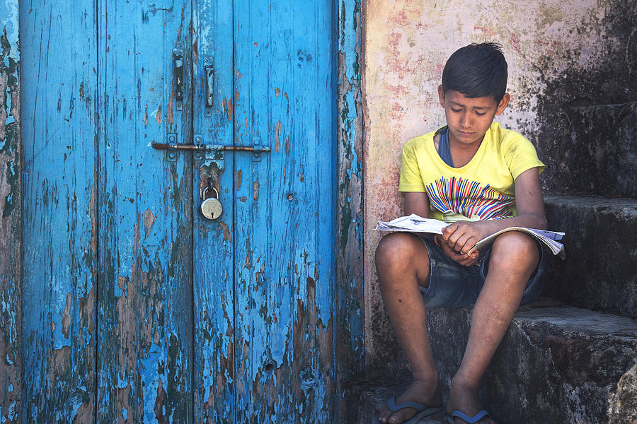 Kid Reading Near Locked Door Photograph by Greenaperture