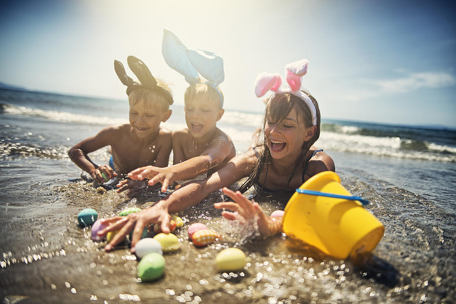 Kids playing in sea during summer Easter Photograph by Imgorthand