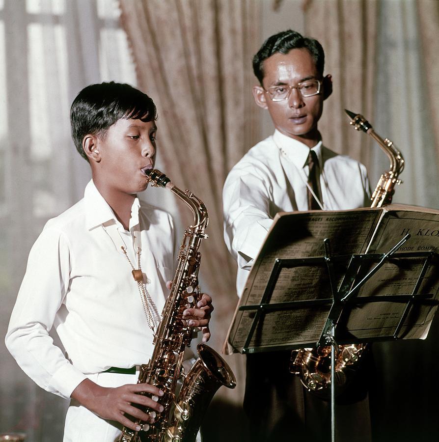 King Bhumibol And Prince Vajirlongkorn Playing Photograph by Henry Clarke