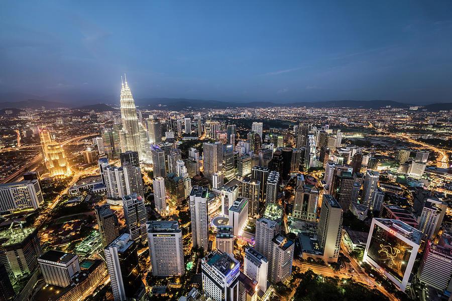 Kuala Lumpur Skyline At Dusk,elevated Photograph by Martin Puddy