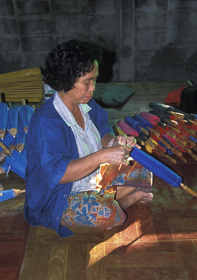 Umbrella Photograph - Lady Makes Umbrellas At A Factory Near Chaing Mai by Richard Berry